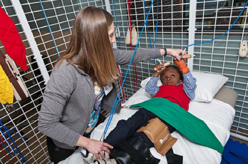 Child doing therapy using a universal exercise unit.
