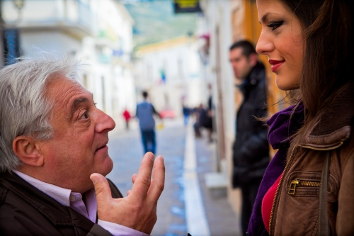 Photo of older man sharing life lessons with younger woman