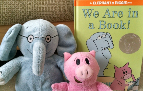 Stuffed elephant and pig with matching book