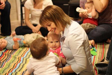 Woman with interacting with 2 babies