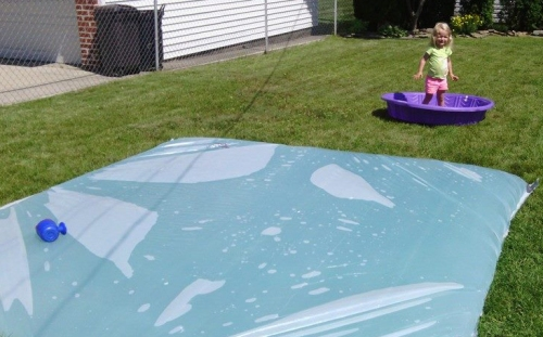 Photo of giant water blob in a backyard