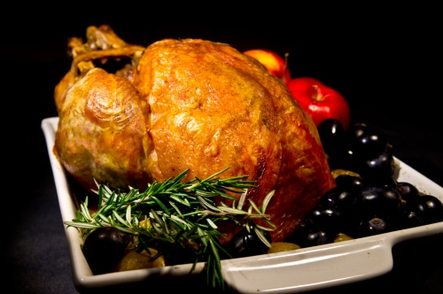 Turkey wtih rosemary and olives in baking dish