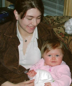 Woman smiling at young baby.