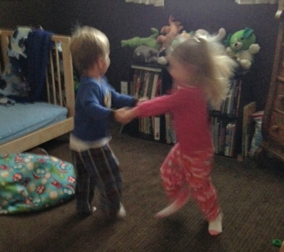 Little boy and girl holding hands and twirling