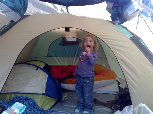 Toddler girl in tent