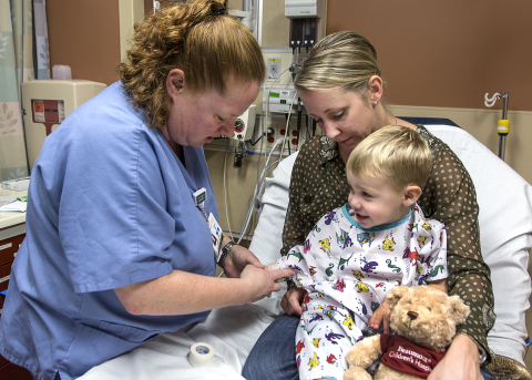 Nurse working on a pediatric patient