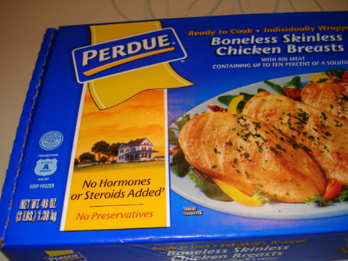"Closeup of ""No Hormones Added"" on Perdue chicken"