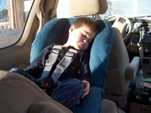 Boy asleep in rear-facing Britax Marathon car seat.