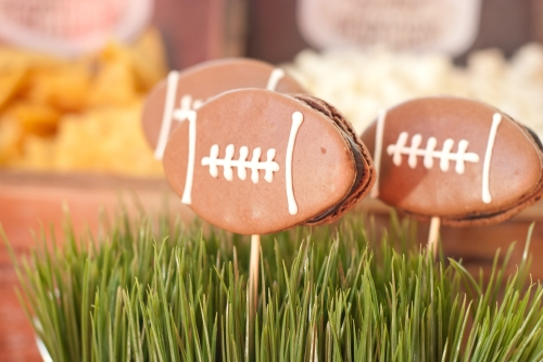 Football cookie picks in grass