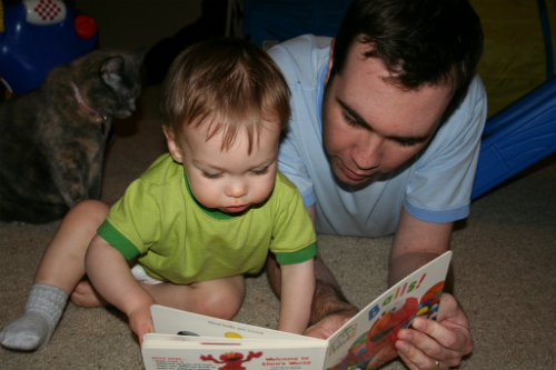 Dad reading to a little boy