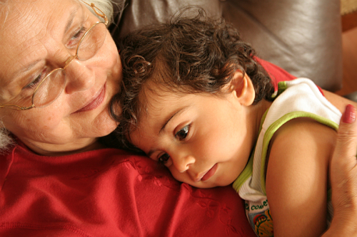 Grandma cuddling with young child