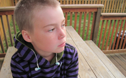 Young boy with earbuds