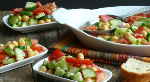 Dishes of cucumber tomato and chickpea salad