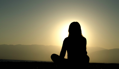 Silhouette of woman covering the sunshine