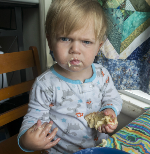 Angry child eating