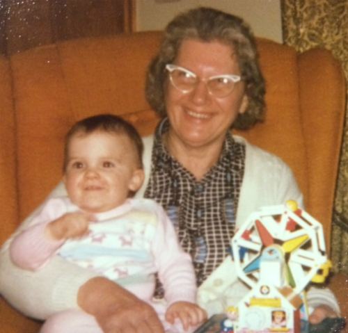 Grandma holding a toddler girl on lap