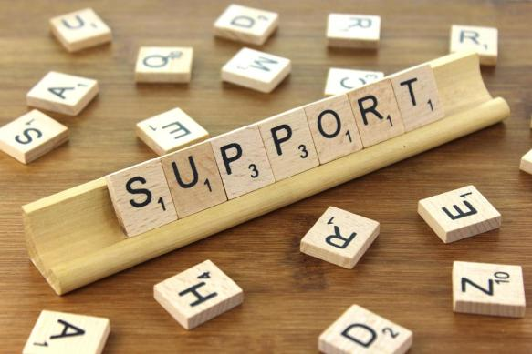 """""""Support"""" spelled out in Scrabble letter tiles"""