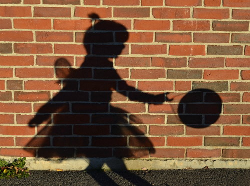 Wall shadow of a little girl dressed as a fairy