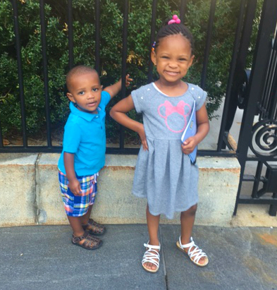 Young girl and little boy siblings