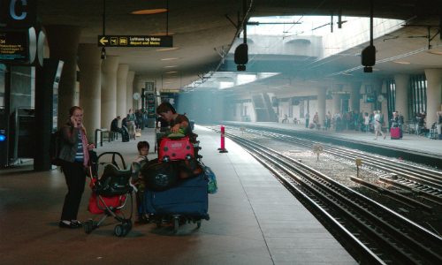 Family with luggage at train station
