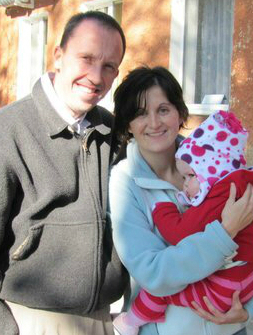 Dad, mom and infant girl