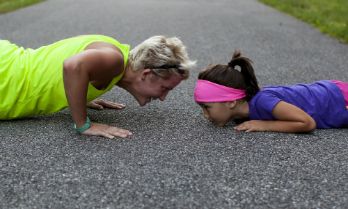 mom and daughter doing push ups