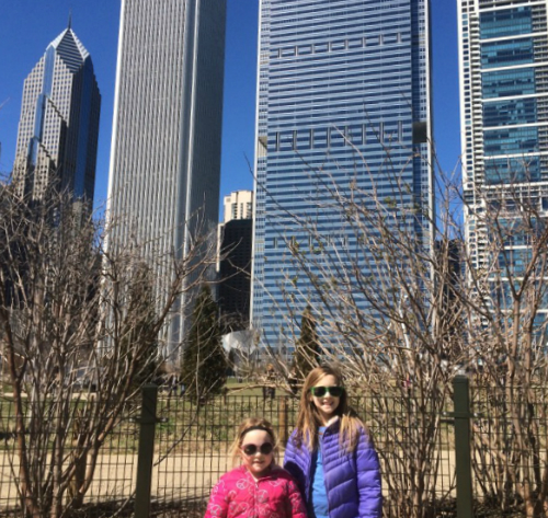 two girls in front of Chicago skyscrapers
