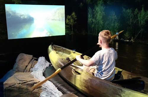 boy in kayak simulator