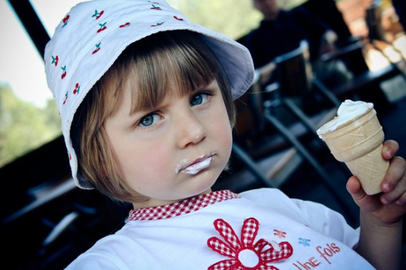 serious looking girl with ice cream