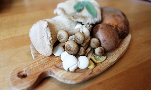 variety of mushrooms on cutting board