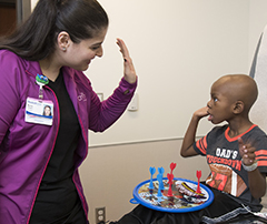 child life specialist working with young boy