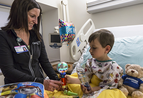 child life specialist with little boy patient