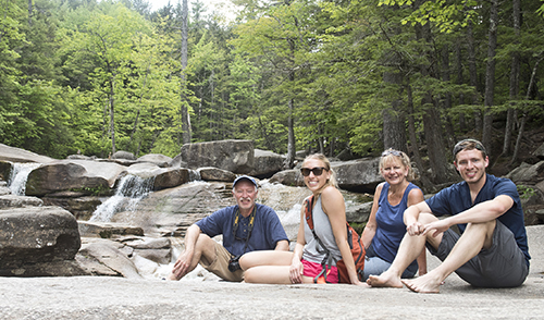 family in front of rocks and waterfalls