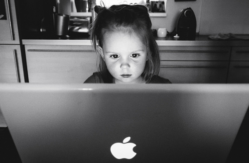 young girl in front of computer screen